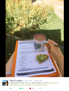 Image of counting with clipboard and coffee in a garden